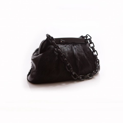 Chanel bag with plastic chain and clasp with Chanel logo.
