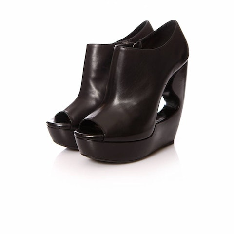 Alaia, black leather wedges in size 39.