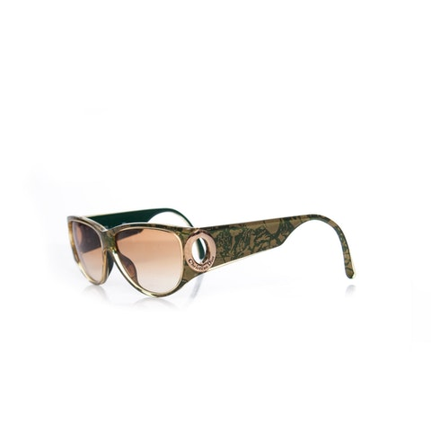 Vintage sunglasses in green and gold.