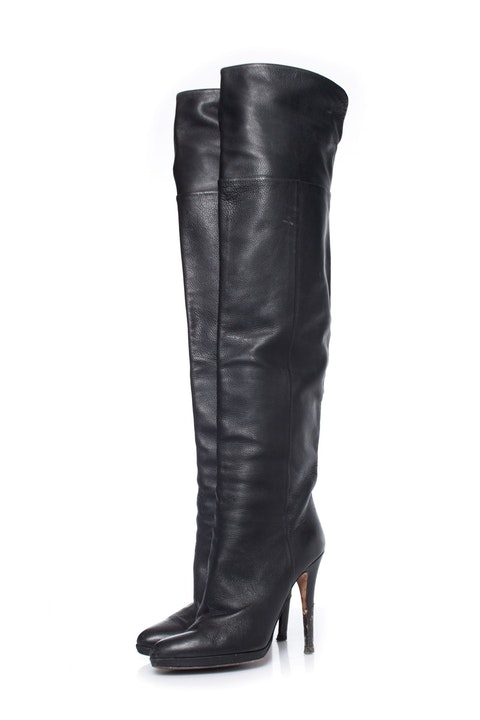Black leather over knee boots.